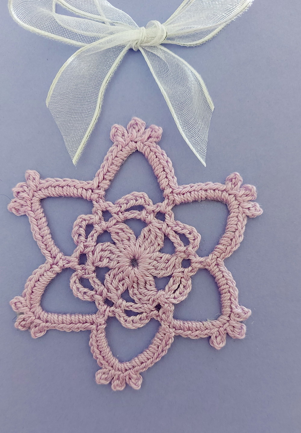 card with crochet flower decoration