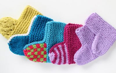 Baby socks knitted flat on two needles